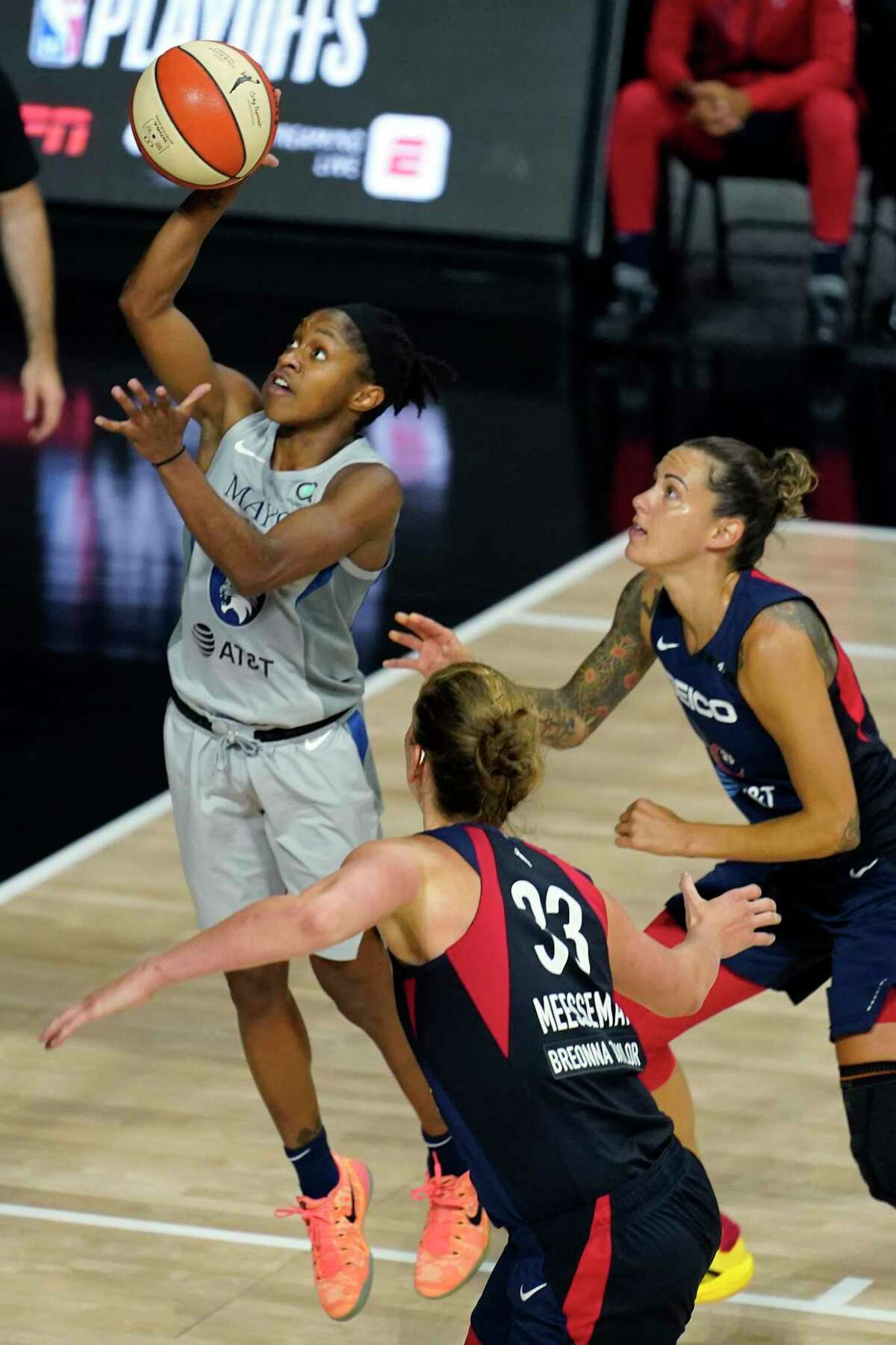 The Lynx's Crystal Dangerfield (2) shoots over the Mystics' Emma Meesseman (33) and Jacki Gemelos (3) during a game earlier the month. Dangerfield, a former UConn star, was named the AP WNBA Rookie of the Year on Tuesday.