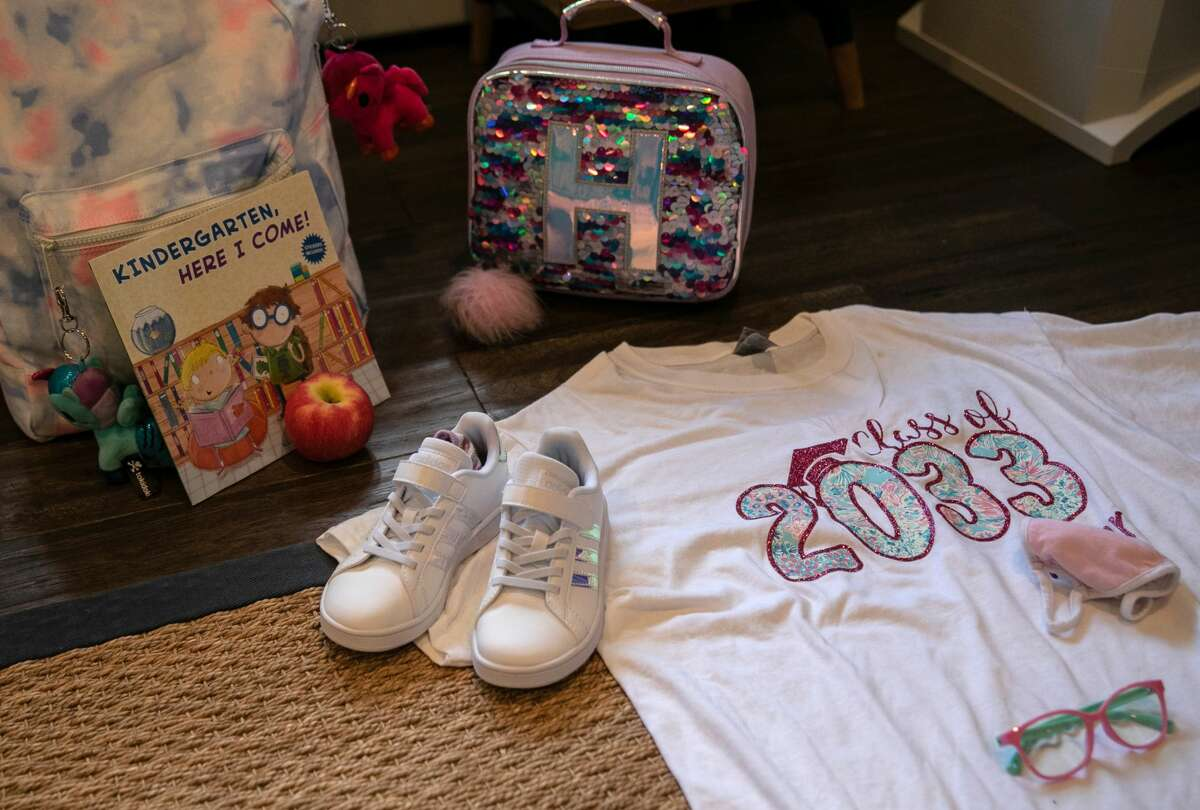 Clothing and items for school lie out before Harper Shea's first day of kindergarten on September 9, 2020 in Stamford, Connecticut.