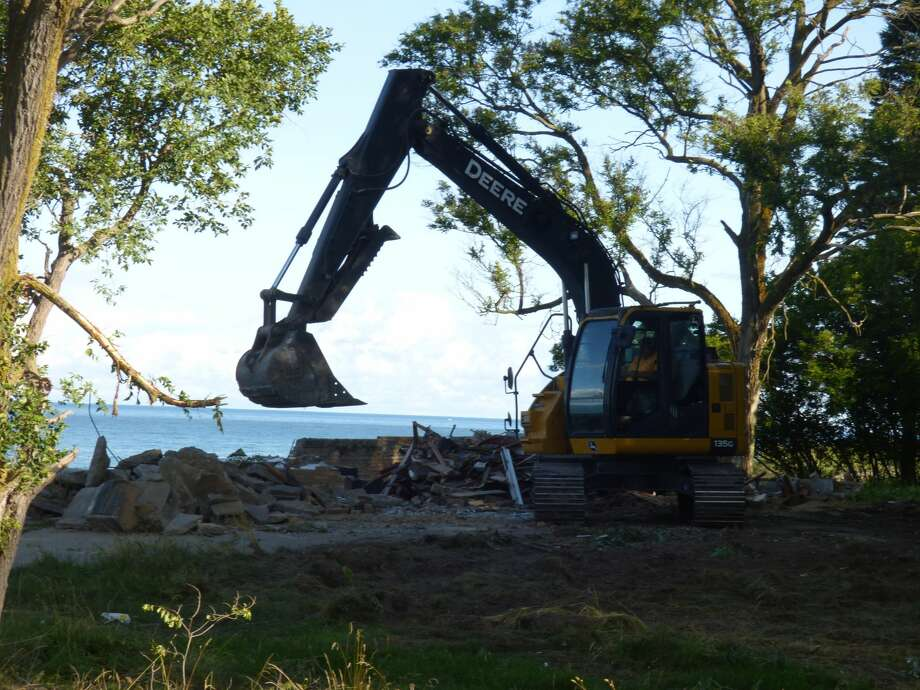 Work crews demolished an abandoned house at risk of plummeting into Lake Michigan in Filer Township last month. Photo: Scott Fraley/News Advocate