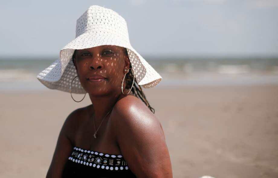 "Shundra Cannon, of Pearland, finds the beach therapeutic. ""It's nice to get away from so much uncertainty, a getaway where you can still feel safe,"" she says. Photo: Elizabeth Conley/Staff Photographer / © 2020 Houston Chronicle"