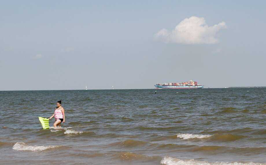 A shipping container makes its way to the Port of Houston, one mile from El Jardin Beach. Photo: Elizabeth Conley/Staff Photographer / © 2020 Houston Chronicle