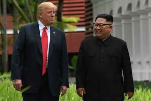 """In June 2018, Trump and North Korean leader Kim Jong Un take a break in talks. """"He never smiled before,"""" Trump told Woodward of the brutal dictator. """"I'm the only one he smiles with."""""""