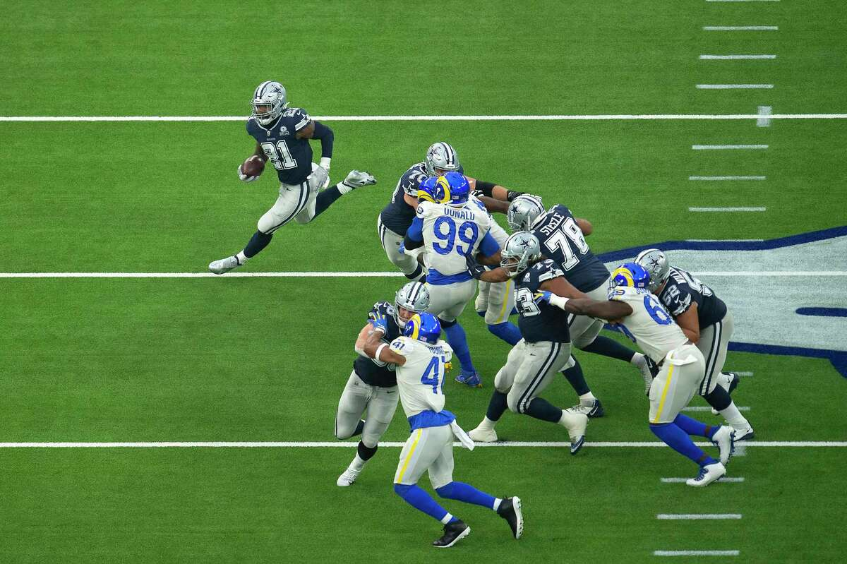 Dallas Cowboys running back Ezekiel Elliott, top left, finds a hole during an NFL football game against the Dallas Cowboys, Sunday, Sept. 13, 2020, in Inglewood, Calif. The game was broadcast on NBC, which averaged 20.5 million viewers for this game and the season opener featuring the Kansas City Chiefs and Houston Texans.