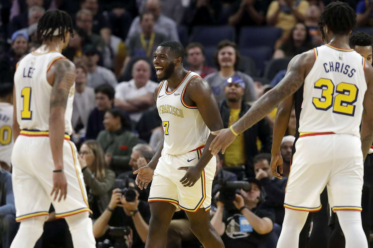 Golden State Warriors forward Eric Paschall (7) celebrates with guard Damion Lee (1) and forward Marquese Chriss (32) during the second half of an NBA basketball game against the Portland Trail Blazers in San Francisco, Monday, Nov. 4, 2019. (AP Photo/Jeff Chiu)