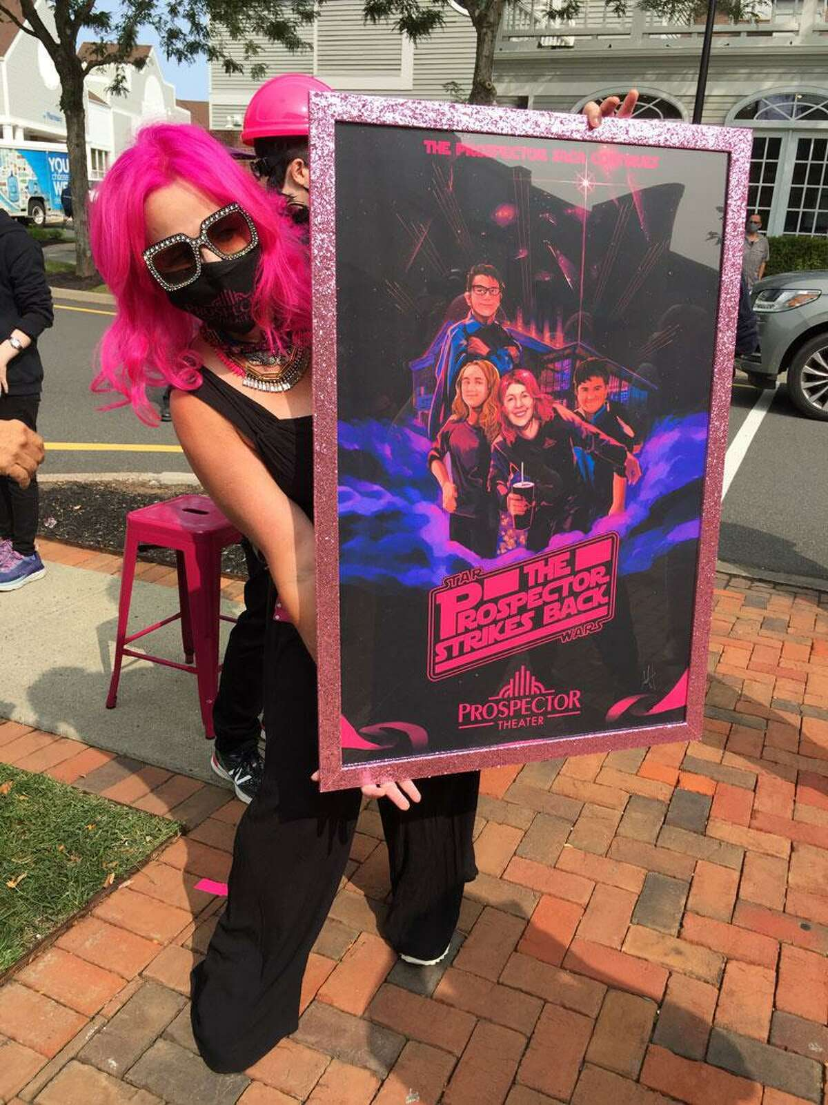 Prospector Theater founder Valerie Jensen with a special poster made in honor of the movie theater's second location in Wilton.