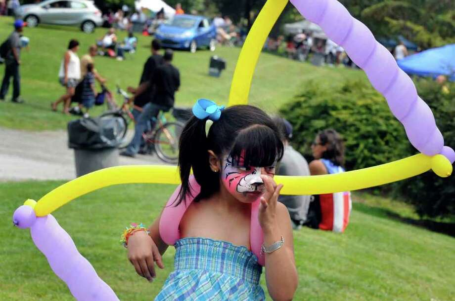 Seven-year-old Alanis Ayala takes in the scenery during the 15th Annual Latin Fest at Washington Park in Albany Saturday, Aug. 28, 2010. ( Michael P. Farrell / Times Union ) Photo: Michael P. Farrell