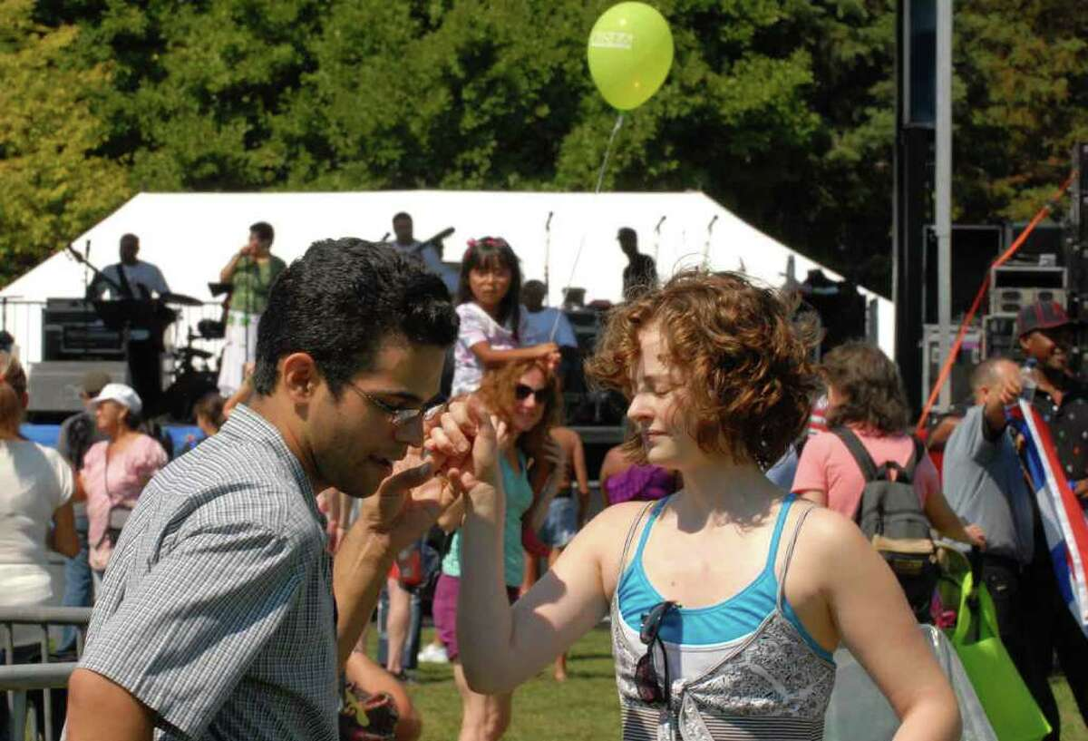 Victor Medina and Kristen Pfisterer of Albany dance to the band Taineri during the 15th Annual Latin Fest at Washington Park in Albany Saturday, Aug. 28, 2010. (Michael P. Farrell / Times Union)