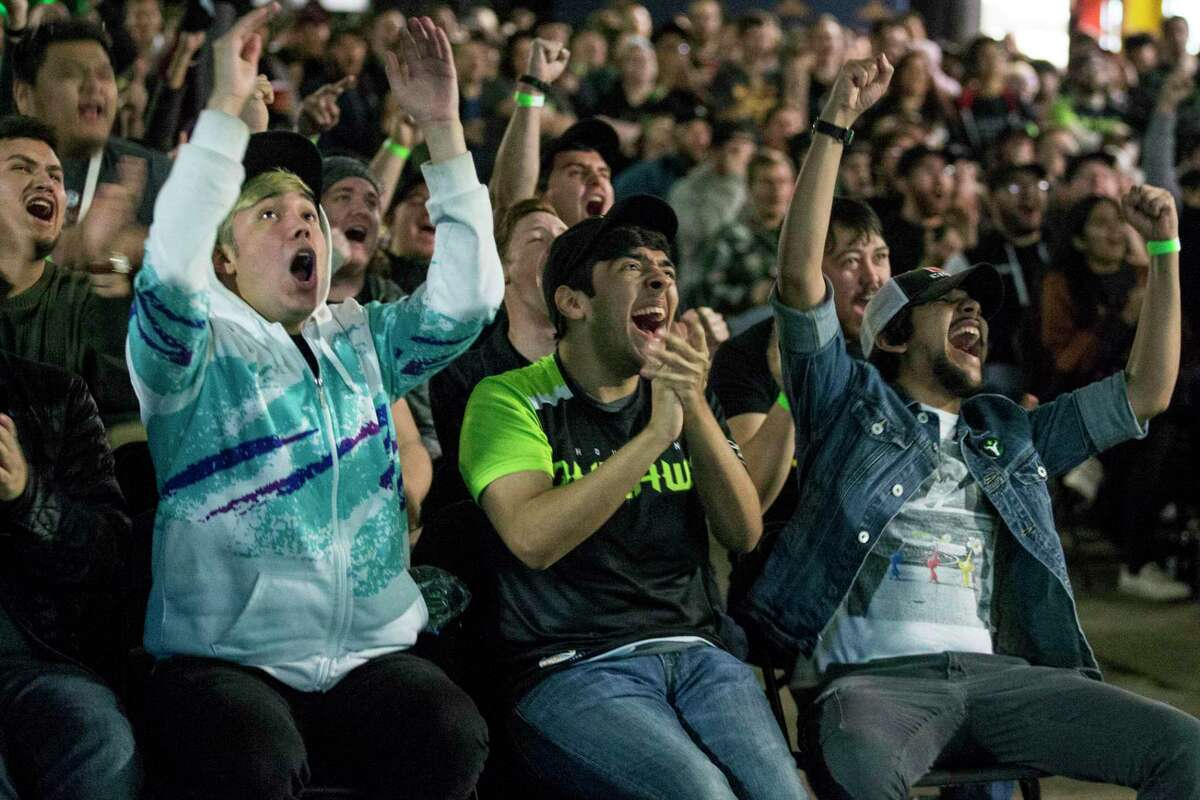 Houston Outlaws fans Brendan Morales, left, Chris Aguirre and Alex Aguirre cheer during a watch party for the Outlaws, an esports team representing the city, at The Cannon on Jan. 11, 2018, in Houston. Lone Star College will host an esports tournament as it works on creating a curriculum for a new sports management associate degree. LSC has partnered with CSL Esports to launch an online tournament.