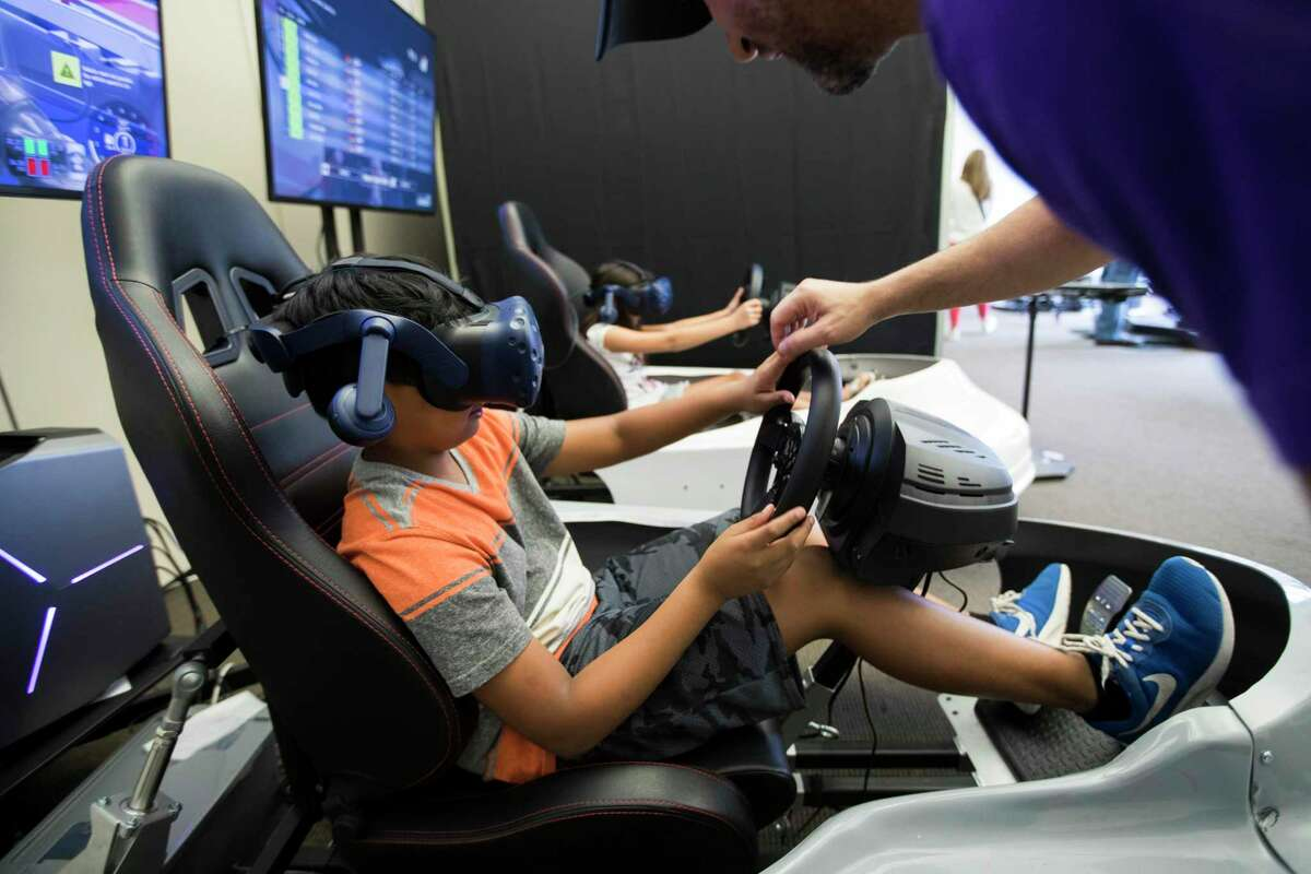 Shaurya Srivastava gets assistance from Chad Modad, founder and co-owner of Omniverse VR arcade in 2018, in Houston. Lone Star College will host an esports tournament as it works on creating a curriculum for a new sports management associate degree. LSC has partnered with CSL Esports to launch an online tournament.