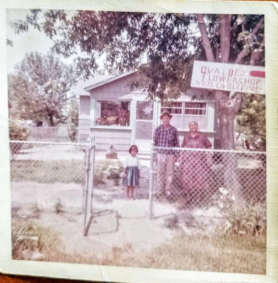 The writer's grandparents standing in front of their home promoting their flower business around the mid to late 1960s. Photo: Sonia Ramirez