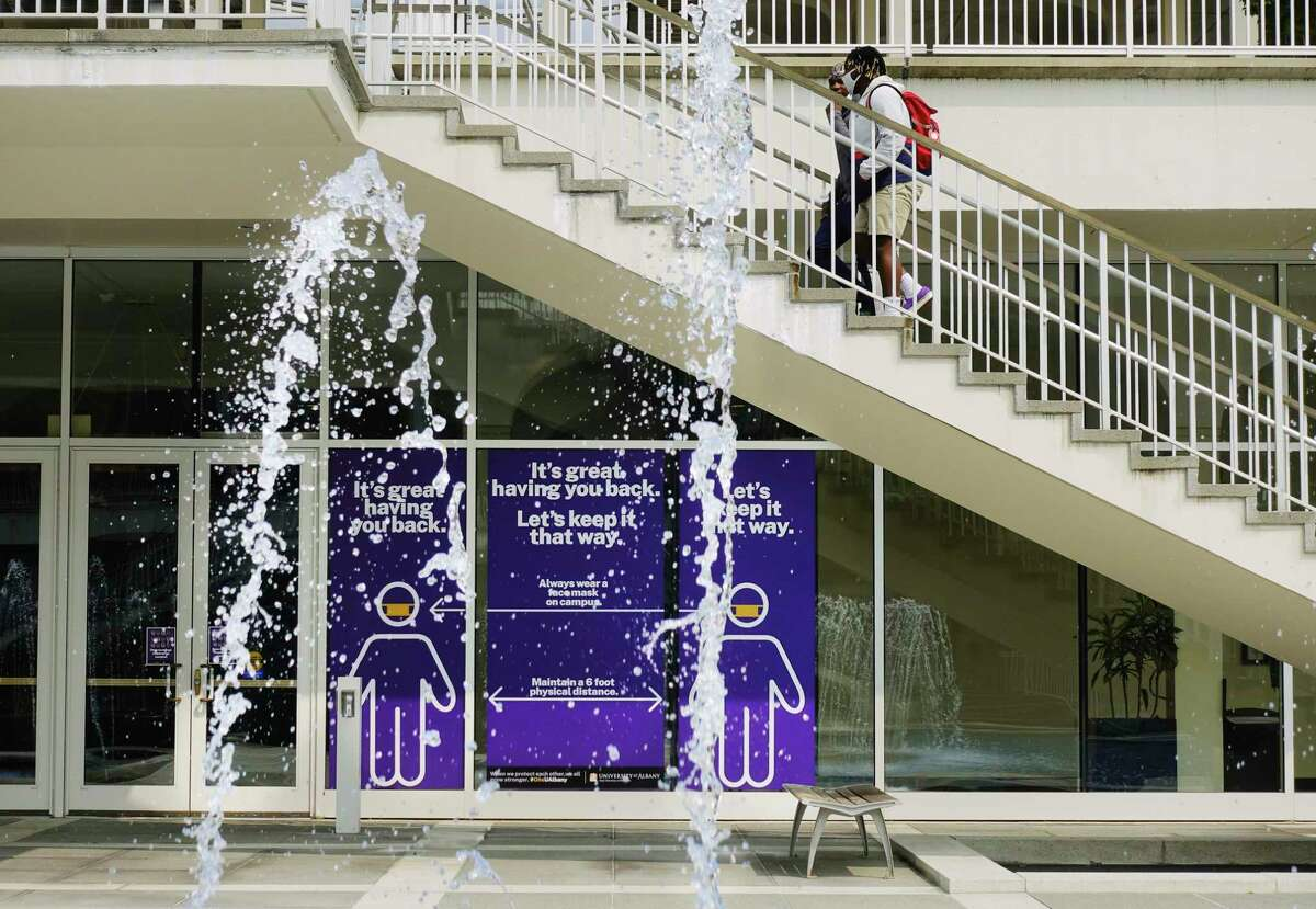 UAlbany students walk up stairs near the fountain on Tuesday, Sept. 15, 2020, in Albany, N.Y. (Paul Buckowski/Times Union)