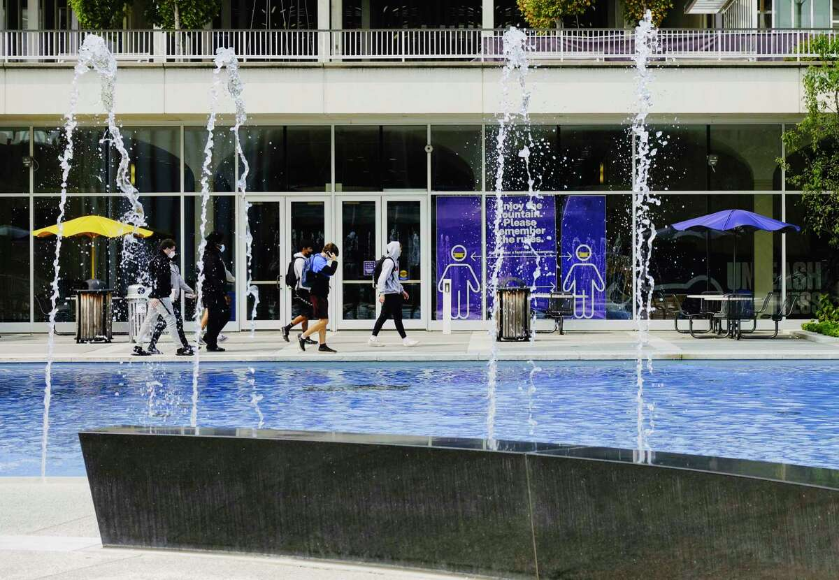 UAlbany students walk past the fountain on Tuesday, Sept. 15, 2020, in Albany, N.Y. (Paul Buckowski/Times Union)
