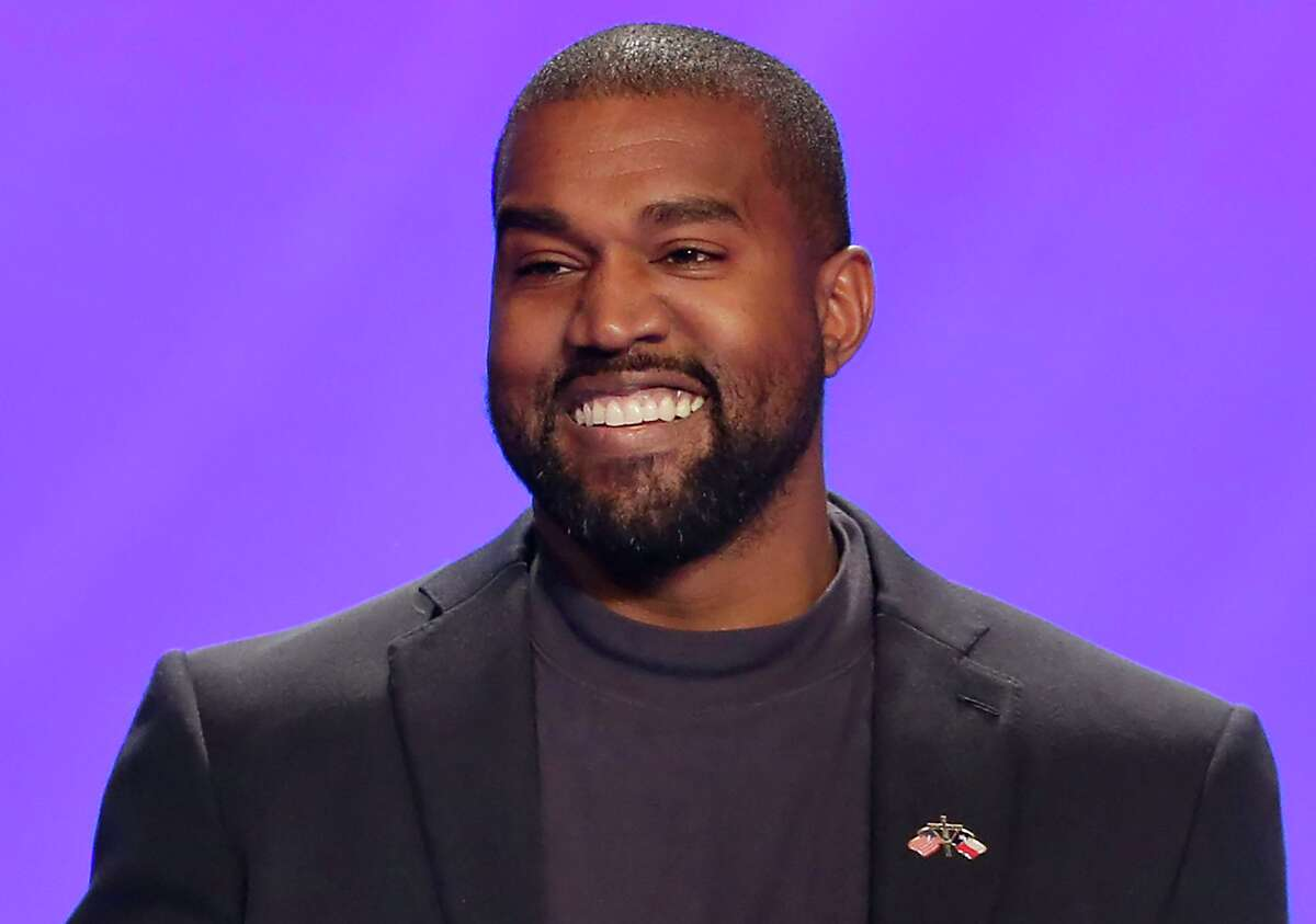 This Nov. 17, 2019, file photo shows Kanye West on stage during a service at Lakewood Church in Houston. (AP Photo/Michael Wyke, File)