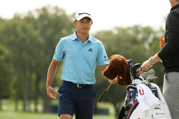 MAMARONECK, NEW YORK - SEPTEMBER 15: Collin Morikawa of the United States hands off his club to his caddie during a practice round prior to the 120th U.S. Open Championship on September 15, 2020 at Winged Foot Golf Club in Mamaroneck, New York. (Photo by Gregory Shamus/Getty Images)