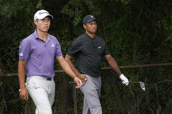 Collin Morikawa, and Tiger Woods head to the second fairway during the third round Saturday, Aug. 29, 2020, for the BMW Championship golf tournament at the Olympia Fields Country Club in Olympia Fields, Ill. (AP Photo/Charles Rex Arbogast)