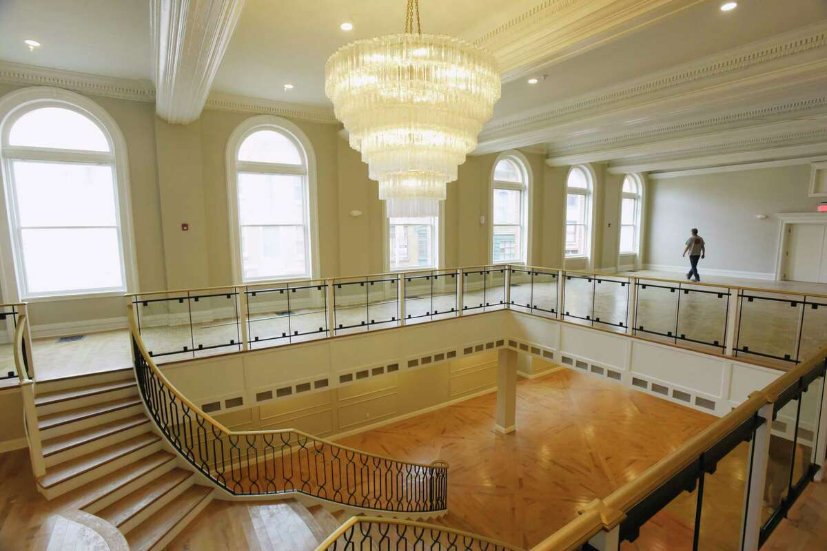 Erik Smith, a project manager for Redburn Property Services, walks across the mezzanine above the grand ballroom inside The Kenmore on Tuesday, Sept. 15, 2020, in Albany, N.Y. The former hotel is going through an extensive renovation project and turning the upper floors into apartments. (Paul Buckowski/Times Union)