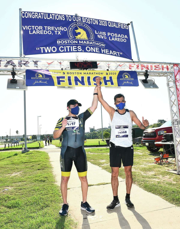 Laredo's Victor Treviño and Nuevo Laredo's Luis Posada celebrate after finishing the 124th Boston Marathon on Sunday, Sept. 13 at Tres Laredos Park. This year's marathon was a virtual run due to the COVID-19 pandemic.