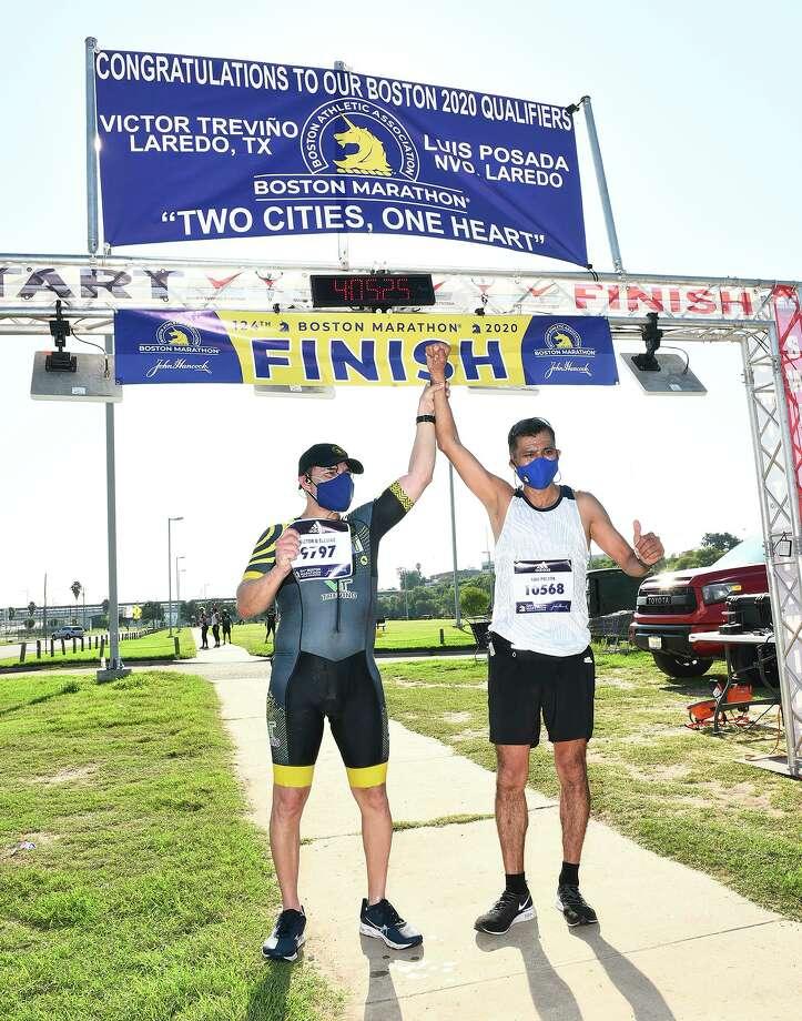 Laredo's Victor Treviño and Nuevo Laredo's Luis Posada celebrate after finishing the 124th Boston Marathon on Sunday, Sept. 13 at Tres Laredos Park. This year's marathon was a virtual run due to the COVID-19 pandemic. Photo: Danny Zaragoza /Laredo Morning Times