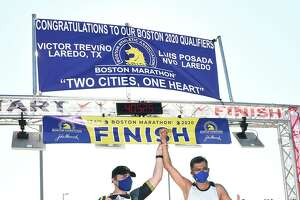 Laredo's Victor Treviño and Nuevo Laredo's Luis Posada celebrate after finishing the 124th Boston Marathon on Sunday, Sept. 13 at Tres Laredos Park. This year's marathon was a virtual run due to the COVID-19 pandemic.