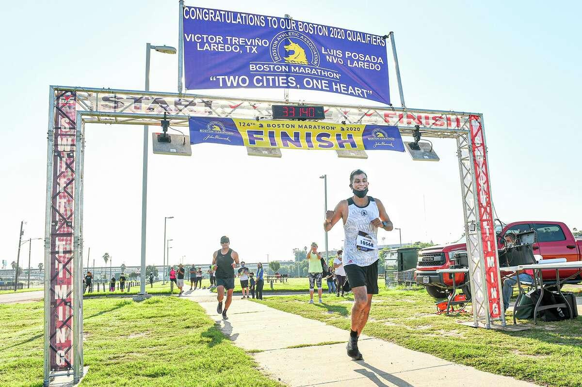 Boston Marathon qualifier and Nuevo Laredo resident Luis Posada finishes the the 124th Boston Marathon, Sunday at Tres Laredos Park. This year's marathon was a virtual run due to the COVID-19 pandemic.