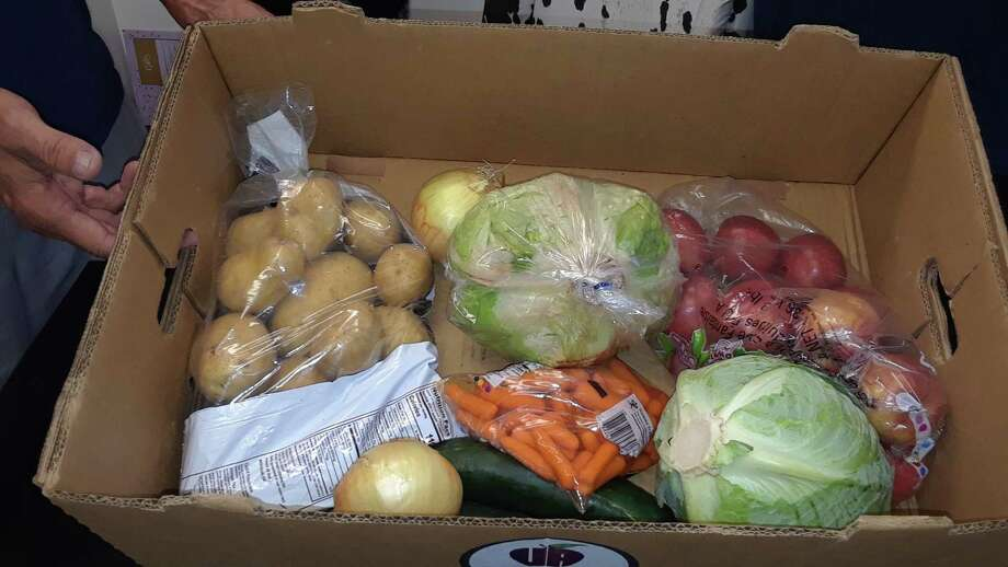 A box of produce at Friendly Hands Food Bank in Torrington. The Farmers to Families food program has provided fresh food to families since May. Photo: Emily M. Olson / Hearst Connecticut Media /