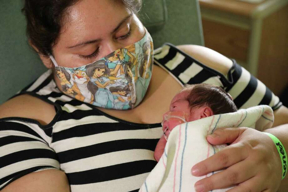 Blanca Rodriguez holds Jade in the intensive care unit of Loma Linda University Health in Loma Linda, Calif. Photo: Loma Linda University Children's Health / The Washington Post