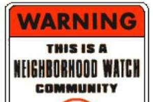 Crime watch neighborhoods are marked with a sign, indicating residents are part of the city's Neighborhood Watch program.