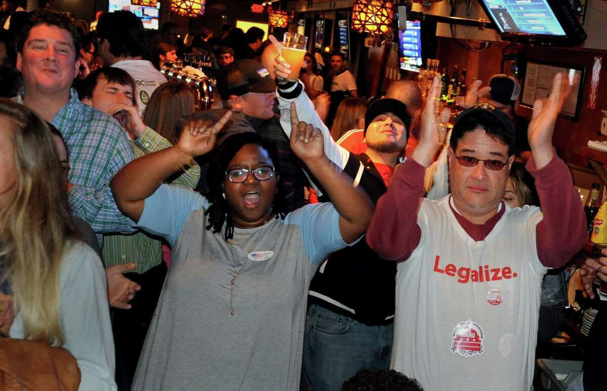 Supporters of legalizing marijuana celebrate on election night in 2014 as early returns showed strong support for Initiative 71.