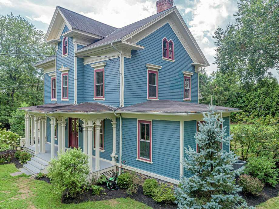 The renovated blue colonial Victorian house at 131 Sport Hill Road is an Easton landmark, built in 1875 for Edwin Godfrey. It was later the home of Samuel P. Senior.