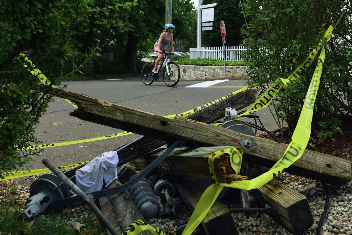 Downed electrical equipment from power lines lines Silvermine Ave. outside of Graybrarns Wednesday, August 12, 2020, in Norwalk, Conn. A week after tropical storm Isias some residents are still without power.