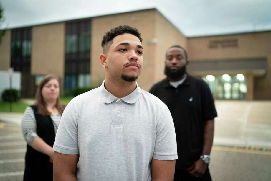 Jordan Keemer, 18, of Pasadena, Md., stands in front of Chesapeake High School with his parents, Nichole Keemer, 38, and Terry Keemer, 40. Terry and Jordan experienced racism as students at the school. Photo: Washington Post Photo By Sarah L. Voisin / The Washington Post