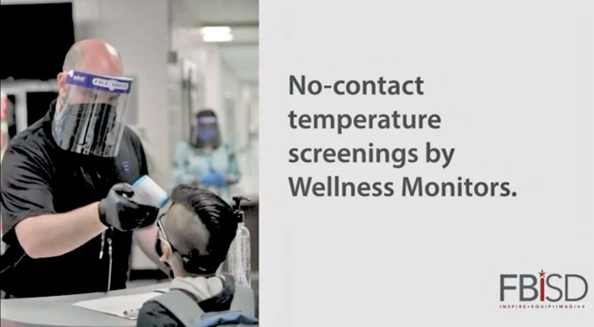 A Fort Bend ISD wellness monitor takes uses a touchless device to check the temperature of student arriving to school in a recent district video.