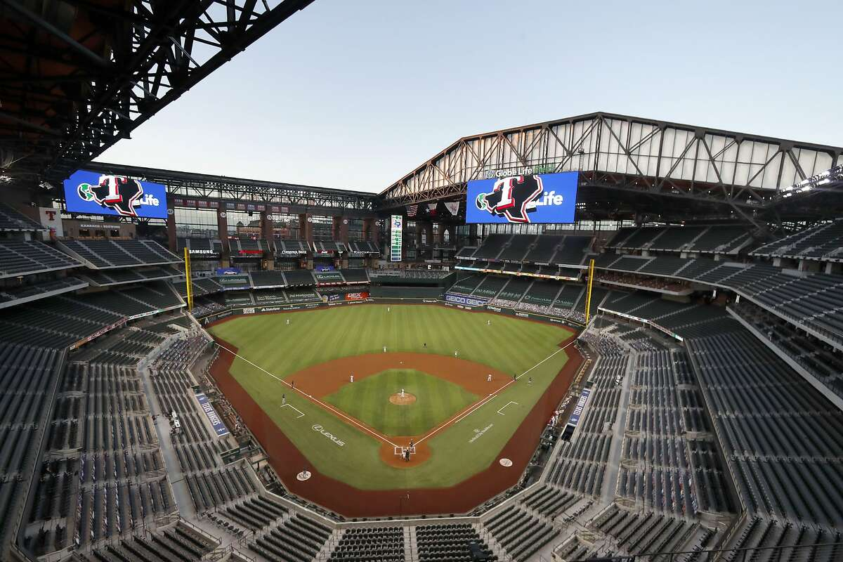 FILE - The Seattle Mariners play the Texas Rangers in the first inning of a baseball game at Globe Life Field in Arlington, Texas, Monday, Aug. 10, 2020. The World Series will be played entirely at the Texas Rangers' new ballpark in Arlington, Texas, as part of a bubble agreement between Major League Baseball and the players' association, the first time the sport's championship will be played entirely at one site since 1944. As part of an agreement finalized Tuesday, Sept. 15, 2020, the Division Series, League Championship Series and World Series will be part of a bubble designed to minimize exposure to the coronavirus. (AP Photo/Tony Gutierrez, File)