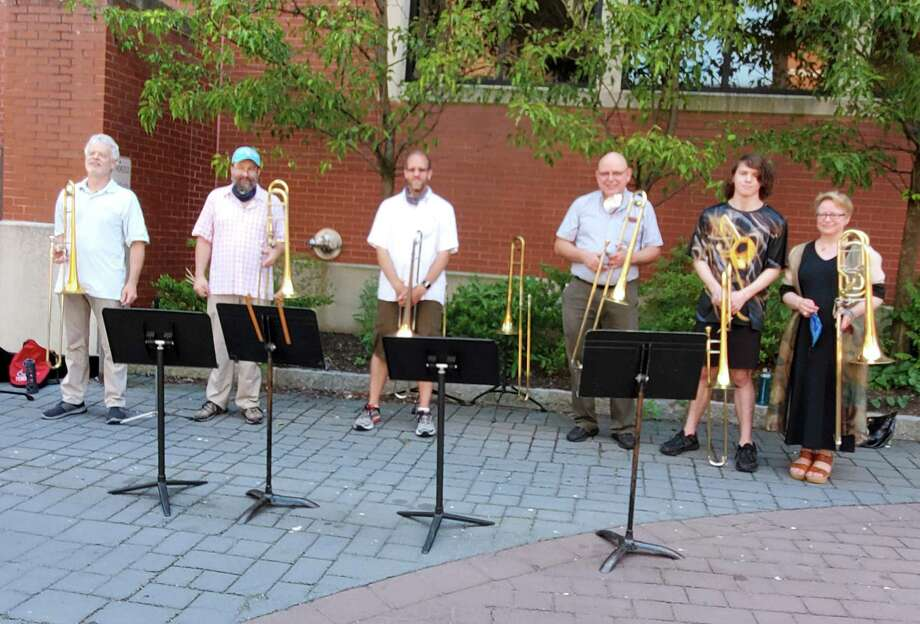 Danbury Trombone Outfit will perform an outdoor show to benefit the Danbury Music Centre on the top floor of Danbury's Bardo Parking Garage, Sept. 20. The group is seen here earlier this summer on Make Music Day. Photo: Contributed Photo