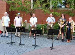 Danbury Trombone Outfit will perform an outdoor show to benefit the Danbury Music Centre on the top floor of Danbury's Bardo Parking Garage, Sept. 20. The group is seen here earlier this summer on Make Music Day.