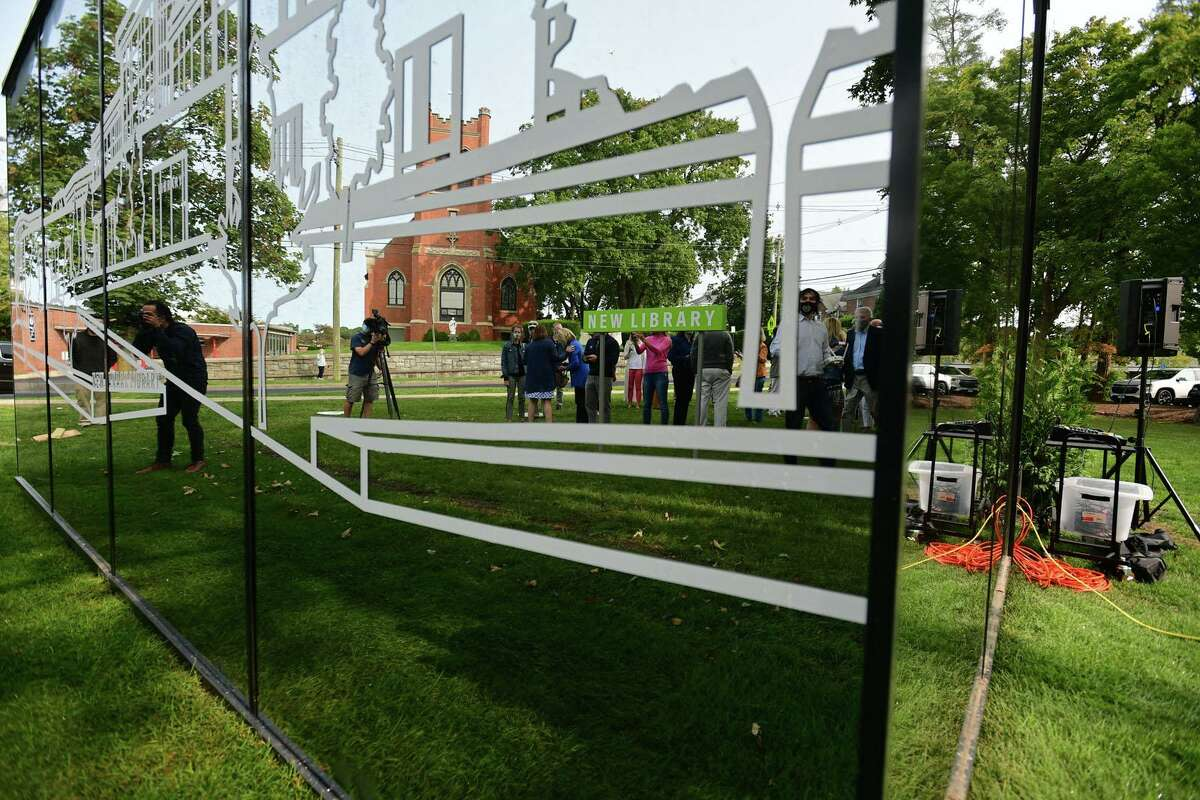 The New Canaan Library unveils a small building, a mirrored cube, to promote the library's planned expansion Tuesday, September 15, 2020, in New Canaan, Conn.