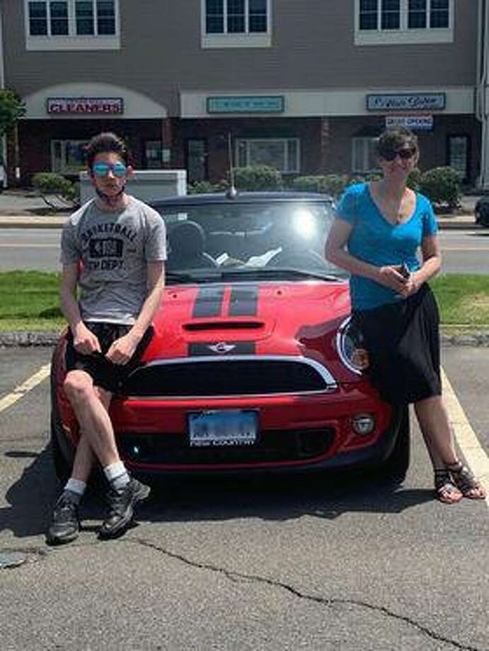 Jenna Linn and her son, Daniel, with her MINI Cooper. Photo: Jason Linn / Contributed Photo