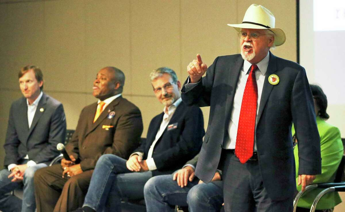 Tom Wakely shouts out his positions with out a microphone as Bexar County Democrat Chairman Manuel Medina hosts a gubernatorial candidate forum at the San Antonio Public Library on February 13, 2018.