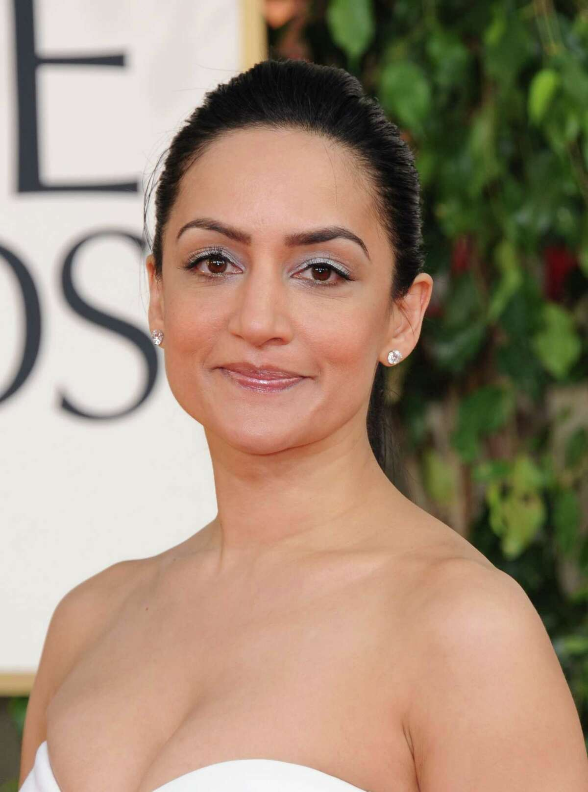 Actress Archie Panjabi arrives at the 70th Annual Golden Globe Awards at the Beverly Hilton Hotel on Sunday Jan. 13, 2013, in Beverly Hills, Calif. (Photo by Jordan Strauss/Invision/AP)