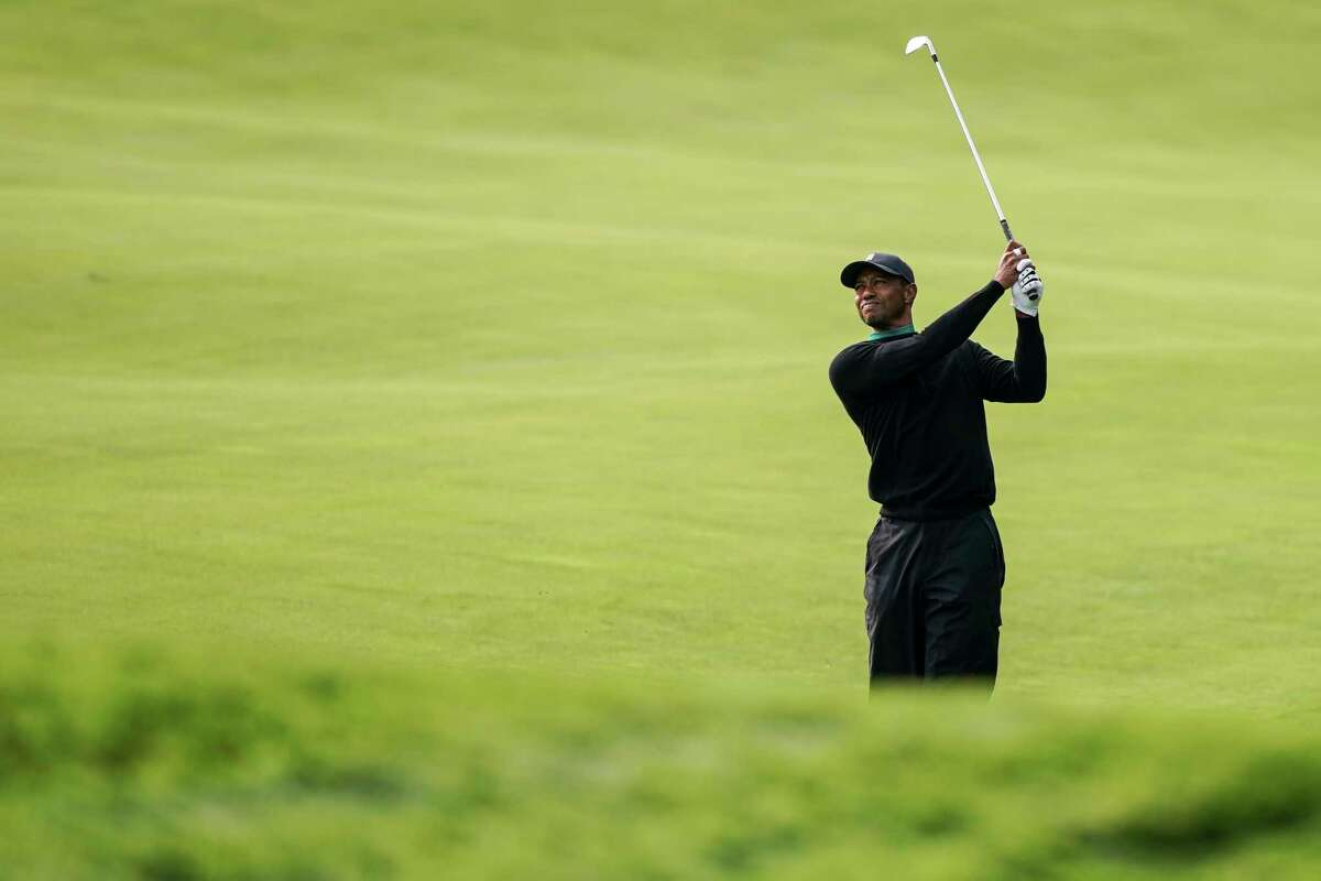 Tiger Woods watches his shot on the 11th fairway during practice before the U.S. Open Championship golf tournament at Winged Foot Golf Club, Tuesday, Sept. 15, 2020, in Mamaroneck, N.Y.