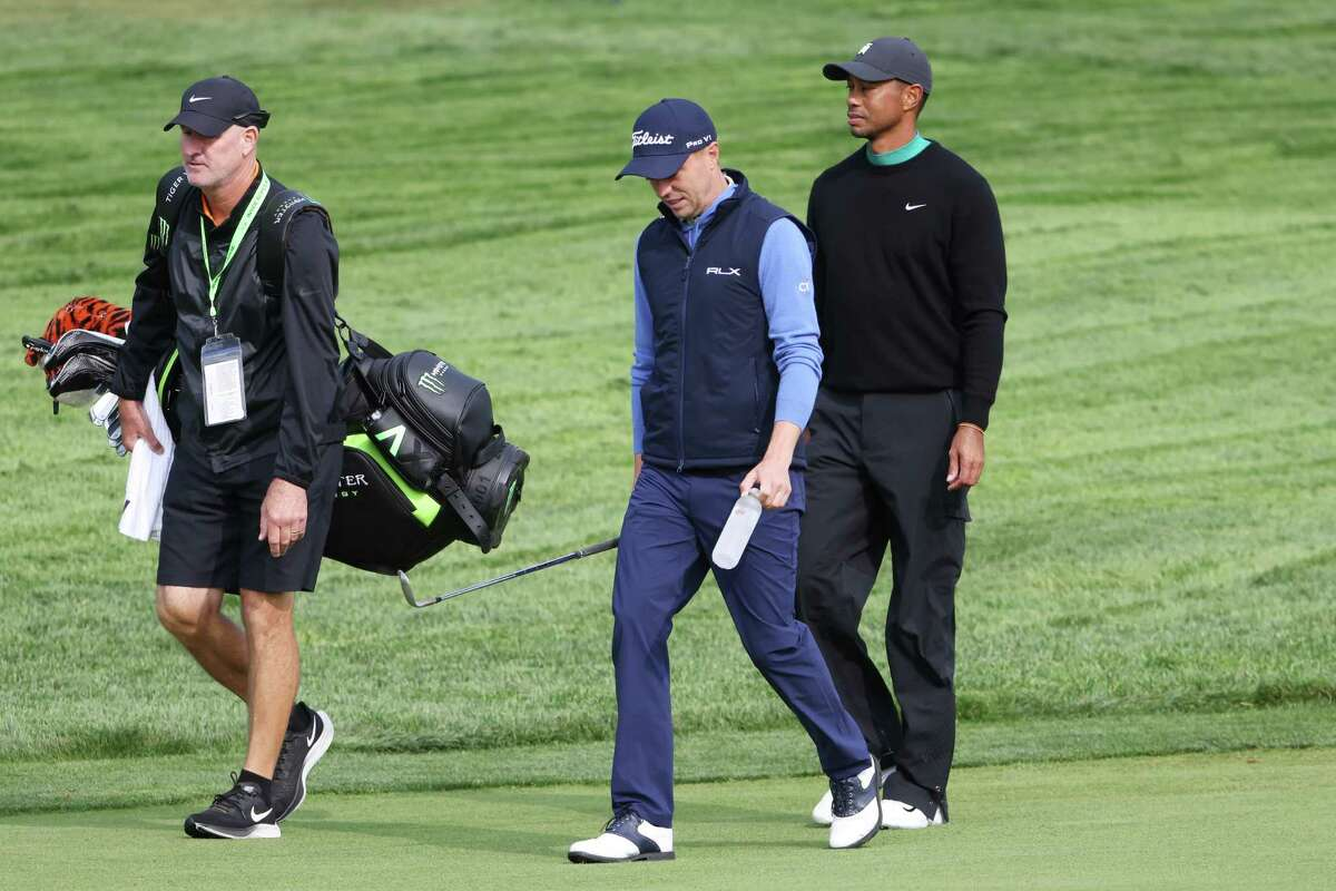MAMARONECK, NEW YORK - SEPTEMBER 15: Justin Thomas (C) of the United States, Tiger Woods (R) of the United States and caddie Joe LaCava (L) walk together during a practice round prior to the 120th U.S. Open Championship on September 15, 2020 at Winged Foot Golf Club in Mamaroneck, New York.