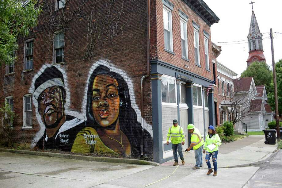 A mural of George Floyd and Breonna Taylor is on a wall of a building along Louisville, Ky.'s Shelby Street in August 2020. Photo: Photo For The Washington Post By Joshua Lott / Joshua Lott