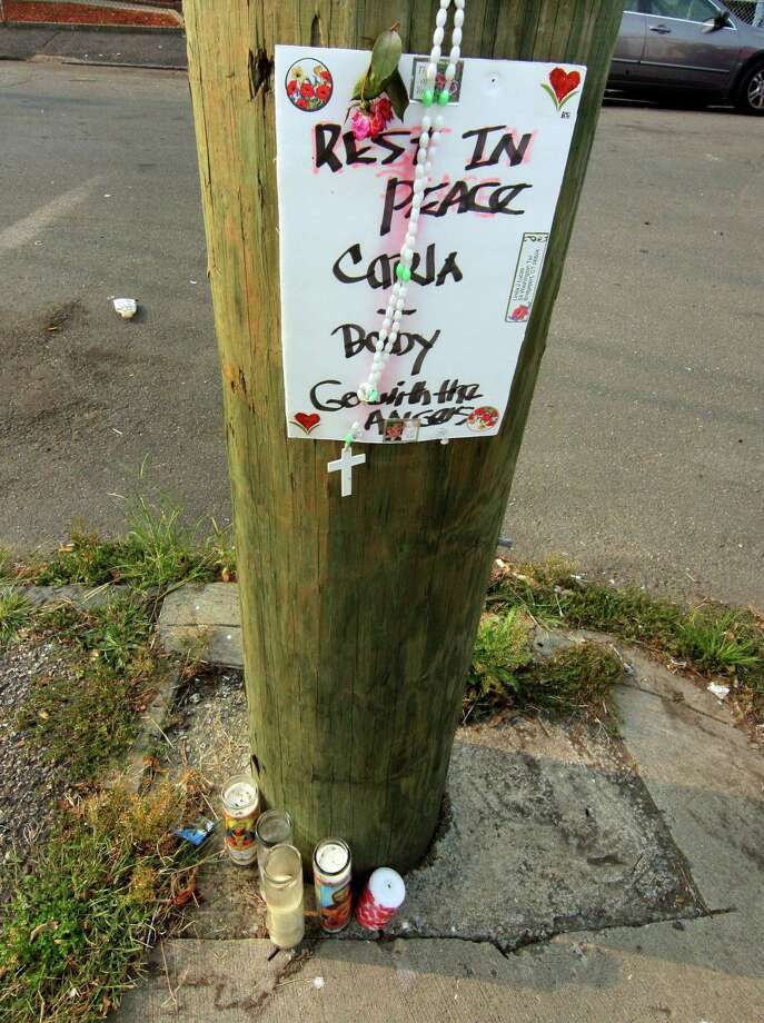 A memorial for 22-year-old Karla Bermudez was set up in front of a home on the corner of Washington Terrace and Washington Place in Bridgeport, Conn., on Tuesday Sept. 15, 2020. Bermudez, who was 23 weeks pregnant, was killed Aug. 31 after assailants fired multiple shots into the large multi-family house she lived in with her boyfriend. Photo: Christian Abraham / Hearst Connecticut Media / Connecticut Post