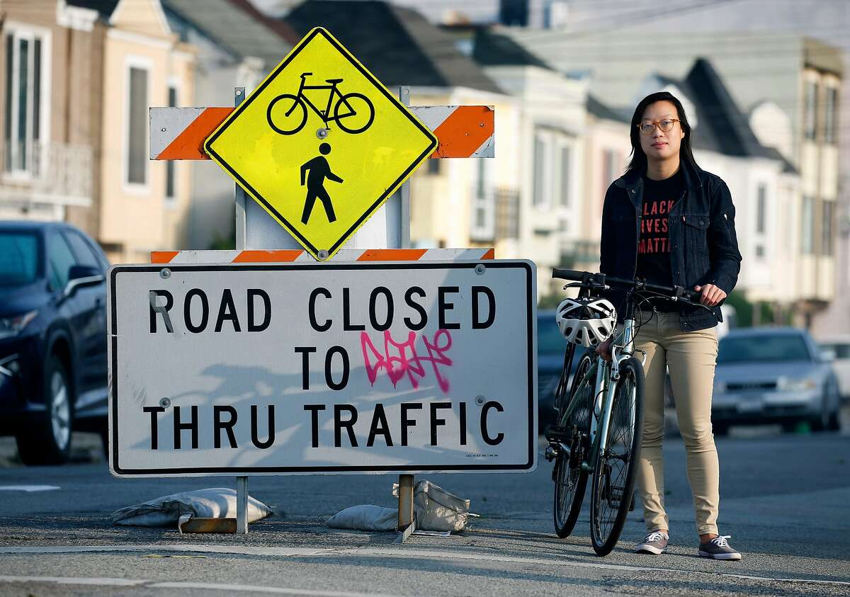 Janice Li, with the SF Bicycle Coalition, stops at a barricade designating 41st Avenue in the Sunset district a