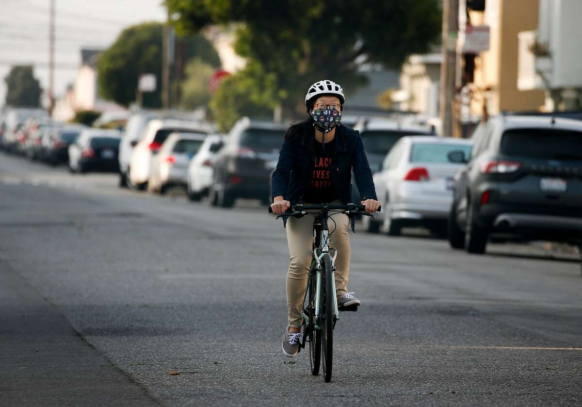 Janice Li rides her bike on 41st Avenue in the Sunset district, a