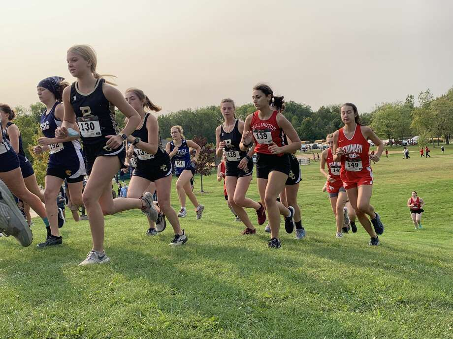 Lilly Platt (130), Jordyn Weiberg (134), and Ella Moses (128) of Bullock Creek compete in the first Tri-Valley Conference West cross country jamboree at Stratford Woods Park in Midland on Tuesday. Photo: Fred Kelly/fred.kelly@mdn.net