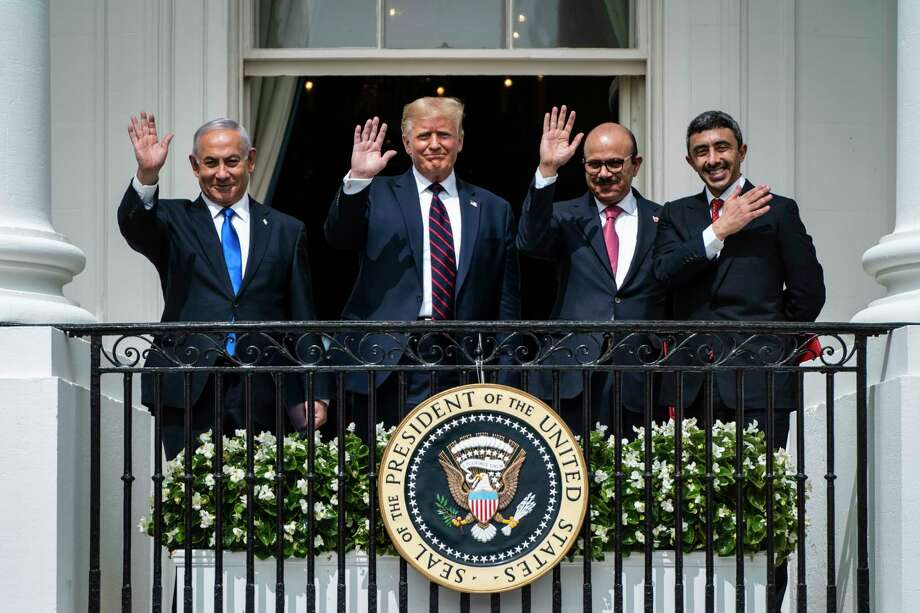Israeli Prime Minister Benjamin Netanyahu, President Donald Trump, Bahrain Foreign Minister Khalid bin Ahmed Al Khalifa and United Arab Emirates Foreign Minister Abdullah bin Zayed Al-Nahyan, stand together during a signing ceremony at the White House on Tuesday. Photo: Washington Post Photo By Jabin Botsford / The Washington Post