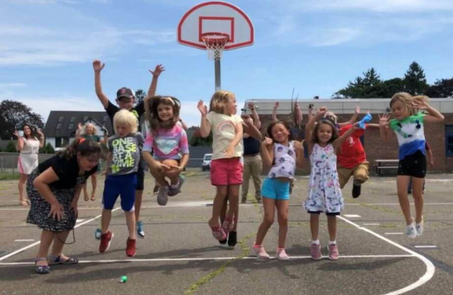Members of the Boys and Girls Club of Milford on the recent installed a new basketball court, funded jointly by the Devon and Milford Rotary clubs. Photo: Contributed