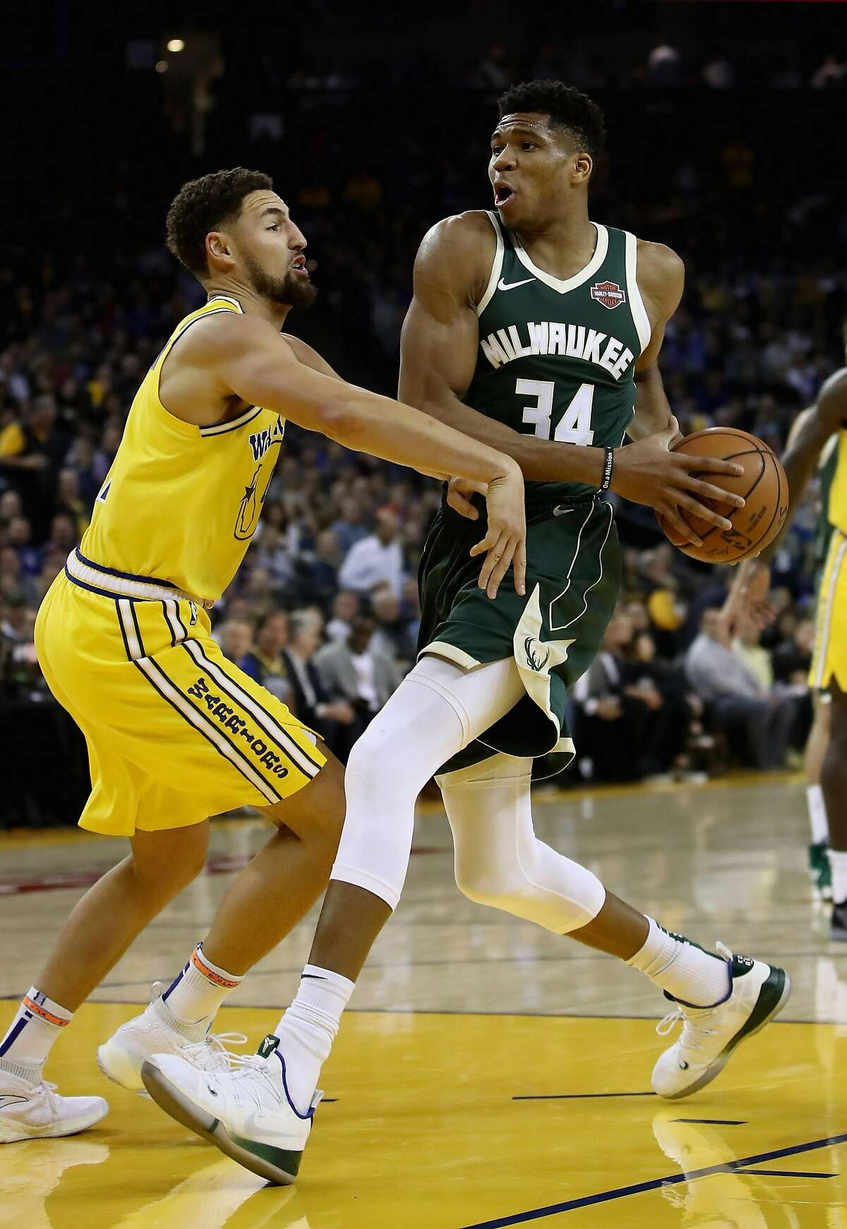OAKLAND, CA - NOVEMBER 08: Giannis Antetokounmpo #34 of the Milwaukee Bucks drives on Klay Thompson #11 of the Golden State Warriors at ORACLE Arena on November 8, 2018 in Oakland, California. NOTE TO USER: User expressly acknowledges and agrees that, b