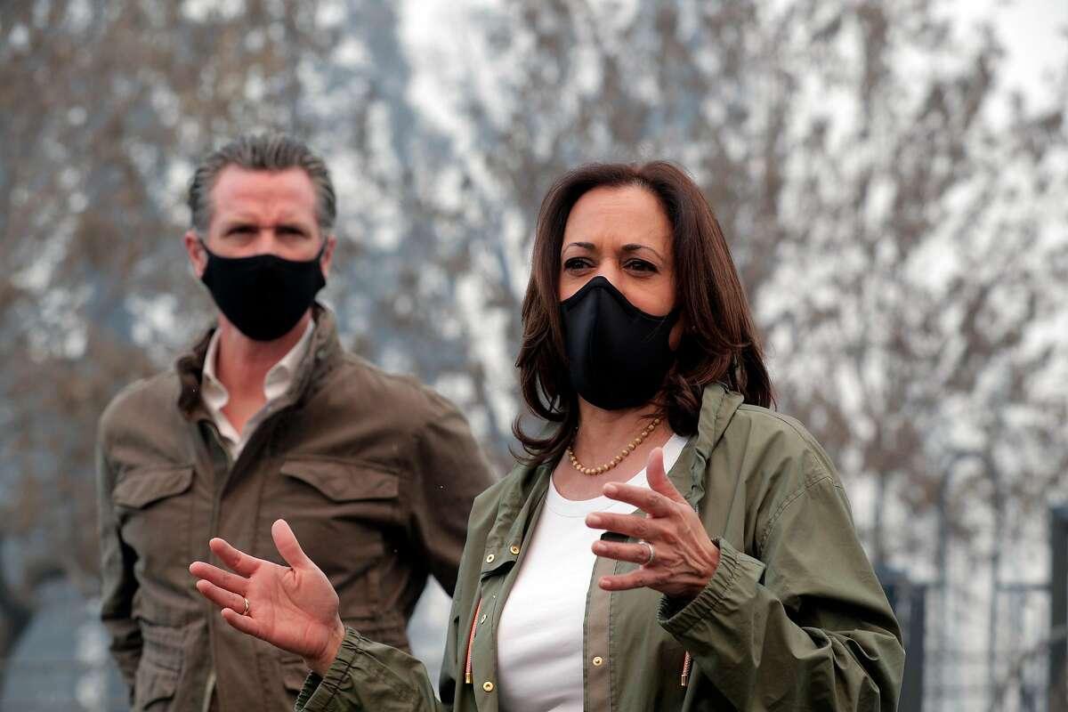 Gavin Newsom and Kamala Harris survey Creek Fire damage in September.